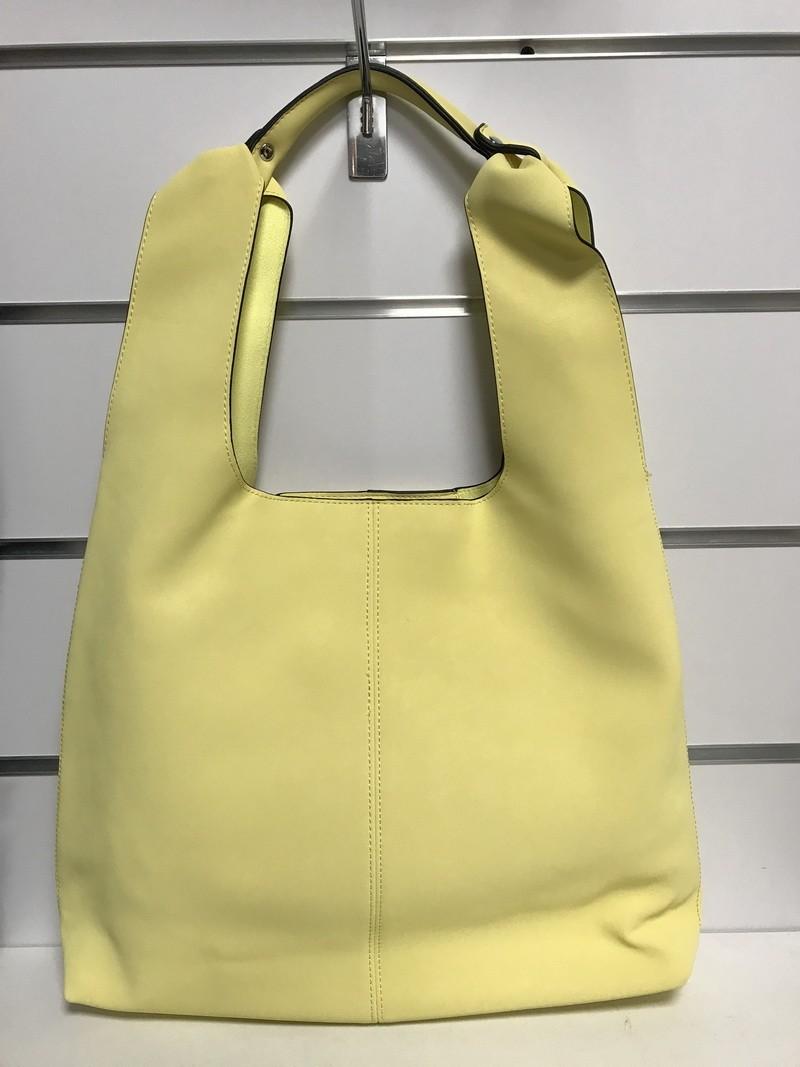 Żółta torba z kosmetyczką